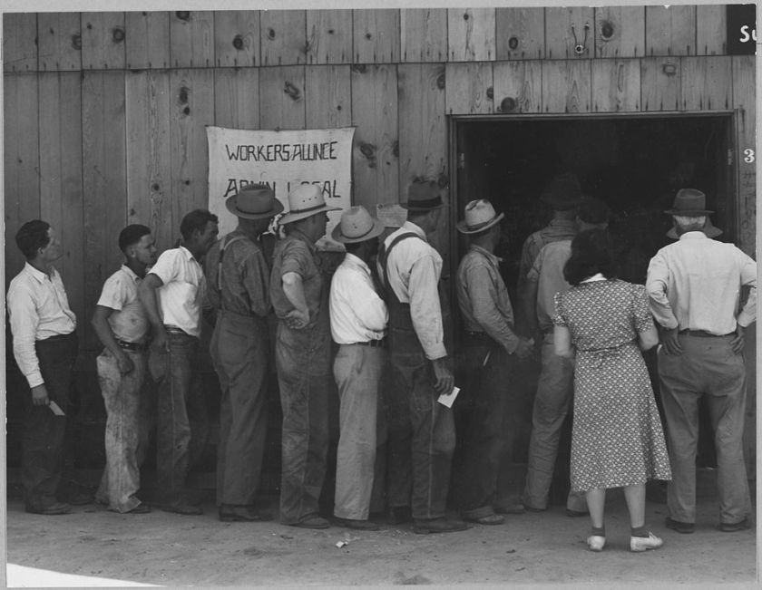 990px-Arvin,_Kern_County,_California._Line_up_for_state_relief_pay_day._Shows_exterior_of_building._This_b_._._._-_NARA_-_521651